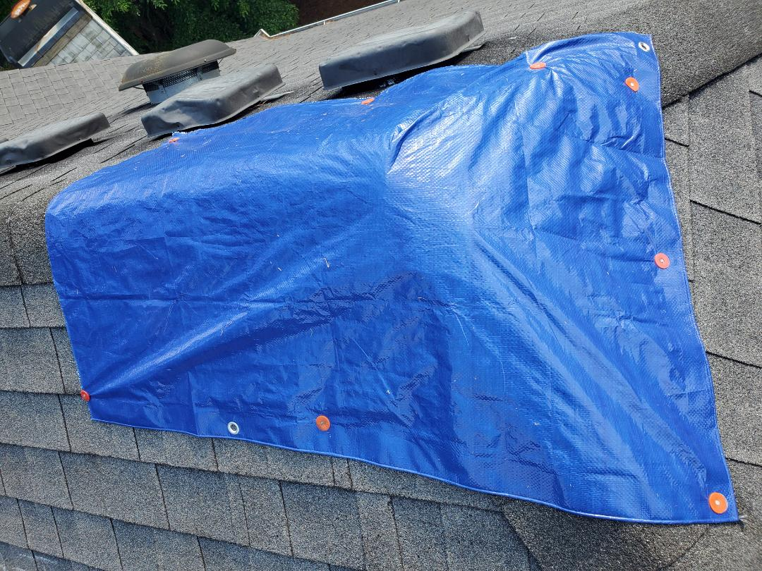 Roswell, GA - Customer called us in the Suwanee Georgia area regarding a leaky roof. Our team came to give a free estimate. We will be replacing the roof through an insurance claim. In the mean time, we setup this tarp for free to keep their home dry.