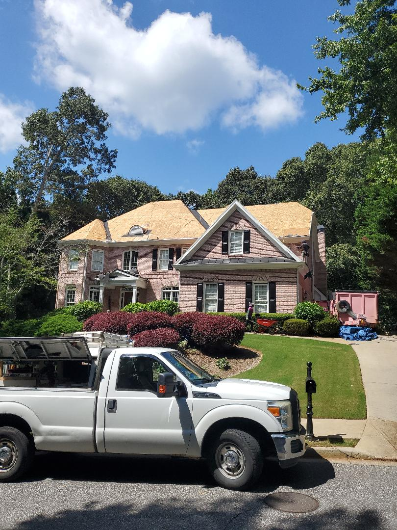 Alpharetta, GA - Today we're replacing the roof for Monica Velez. Due to the last storm in the area she had roof leaks in her house, so she contact Future roof and restoration llc. And we came out gave her a free inspection and file a claim through her insurance company. Insurance company adjuster came out and agreed to pay for the roof replacement. The client is very excited to get a brand new roof. We're using GAF timberline HDZ and the color is charcoal.