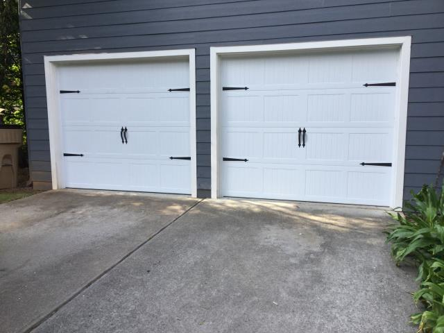 Cumming, GA - Installing two 8'x7' carriage style garage doors with decorative handles and hinges.