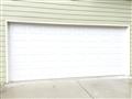 Lawrenceville, GA - Installing 16' x 7' CHI 2251 insulated garage door with almond vinyl trim.