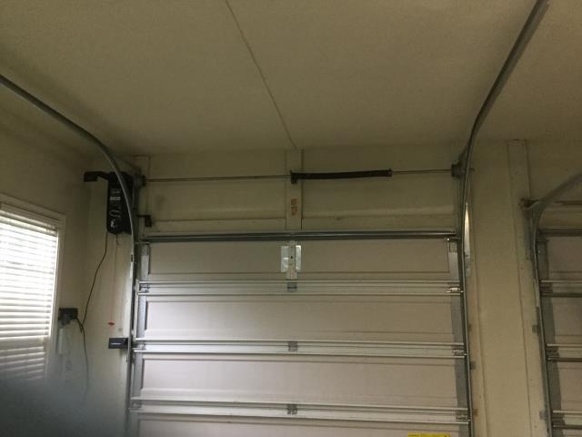 """Cumming, GA - Installing 32"""" track for 8 ft garage door. Installing 8500 garage door sensors. Installing LiftMaster WLED garage door operator."""