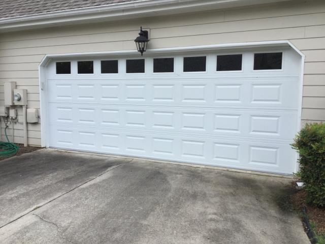 Suwanee, GA - Installing 18'x7' CHI panel garage door with windows.