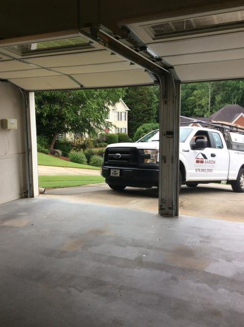 Alpharetta, GA - Installing 7ft belt and rail on garage door. Servicing garage door.