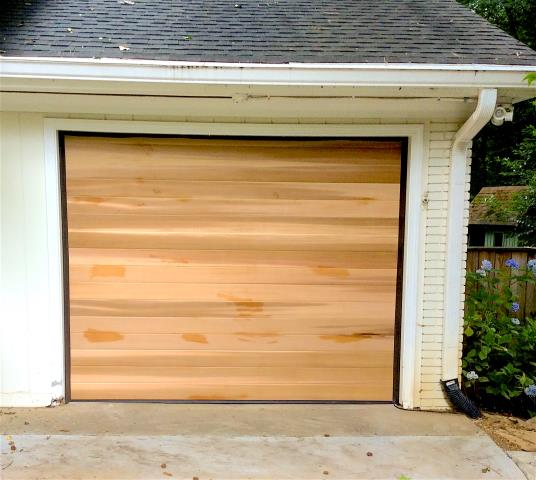 Atlanta, GA - Installing custom 8-9 x 6-11 western red cedar wood garage door.