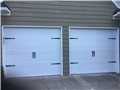 Alpharetta, GA - Installing two CHI 8' x 7' Carriage stamp garage doors with two LiftMaster 8355W motors and LiftMaster 877LM Keypad.