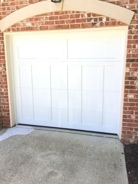 Cumming, GA - Installing two CHI 5600 8ft by 7 ft garage doors with Blue Ridge decorative steel stamp handles.