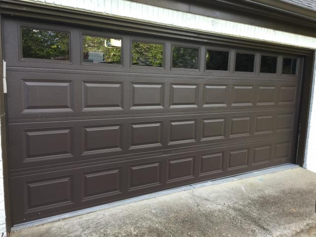 "Installing CHI 2251 16ft x 6'9"" insulated garage door with windows. Installing LiftMaster 8355W garage door motor and 7ft belt rail."
