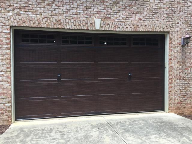 Alpharetta, GA - Installing woodgrain CHI 5251 16ft x 8ft9in garage door with windows and carriage stamps.