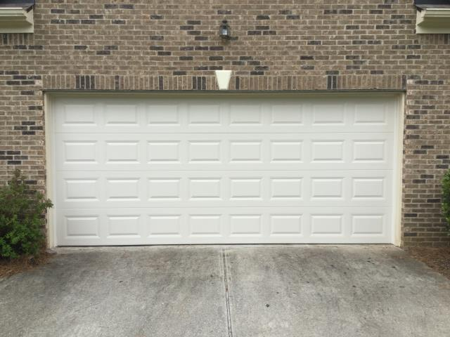 Dacula, GA - Installing CHI 2216 16ft x 7 ft short panel, insulated,garage door. With 20k cycle torsion springs.