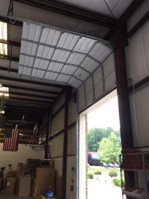 Buford, GA - Resetting Torsion springs and motor on commercial garage door.