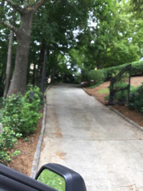 Atlanta, GA - Servicing residential gate and garage door. Installing LiftMaster 375UT universal remote.