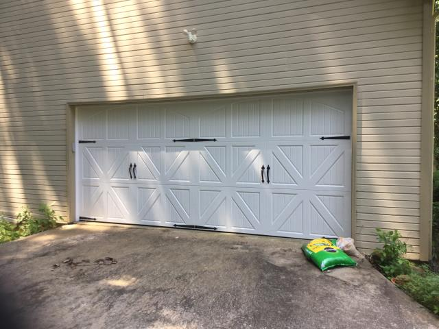 Cumming, GA - Installing 16'x7' Amarr Classica 3000, solid white, arched Santiago design, garage door with two sets of blue ridge handles.