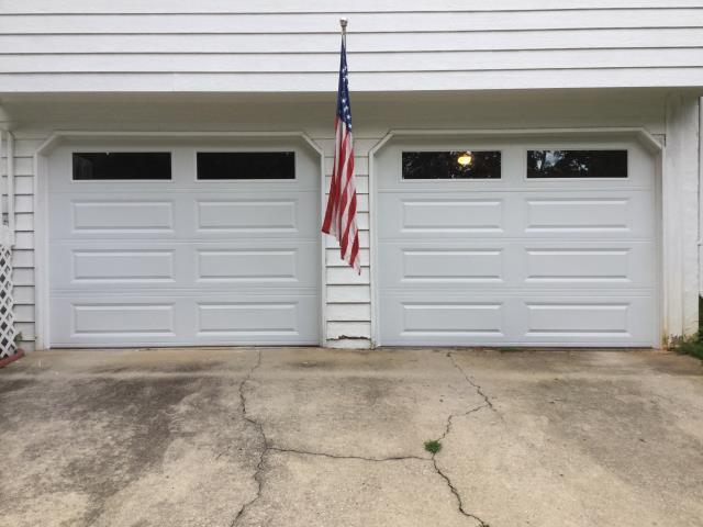 Installing two CHI 4251 9'x7' insulated white garage doors with windows. Installing LiftMaster 8010 garage door opener. McGinnisD07@gmail.com