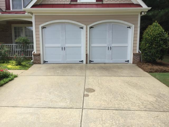Cumming, GA - Installing two CHI 5300 8'x8' white garage doors with carriage overlay and insulated.
