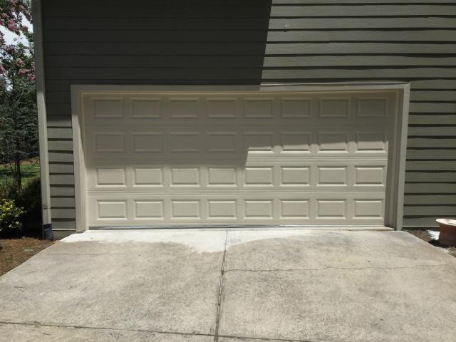 Cumming, GA - Installing CHI 2251 16'x7'  short panel, insulated, almond, garage door.