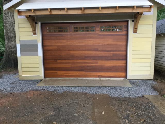 Installing 12'x8' CHI Cedar Plank Door with windows and insulation. Installing LiftMaster 8500W. Servicing garage door.