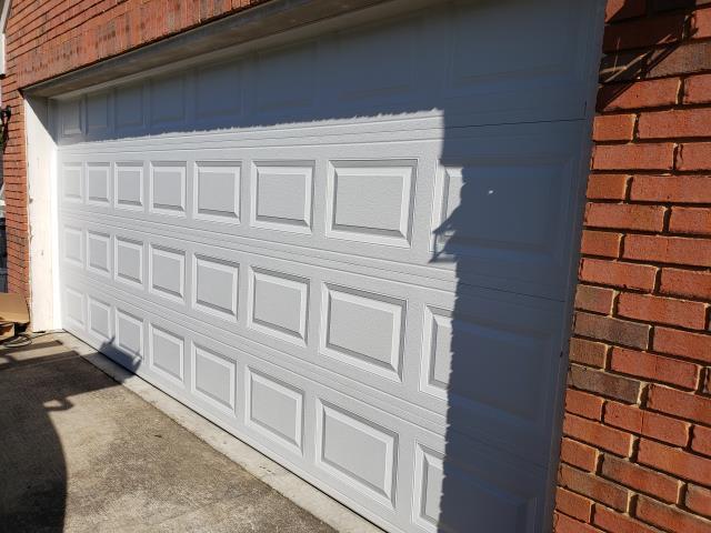 Dacula, GA - Installing CHI 2283 16' x 7' garage door, short panel raised. Installing LiftMaster WLED garage door opener and servicing garage door.