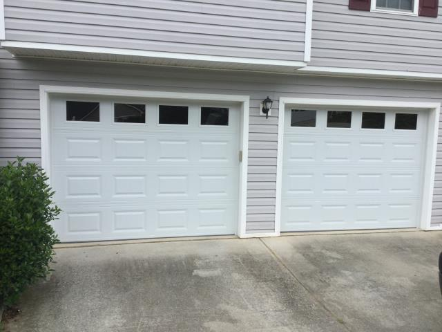 Installing CHI 2250 garage doors, with windows, short panel raised. Servicing garage door.