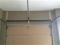 Replacing broken torsion springs. Servicing garage door.
