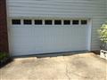 Installing CHI 2251 garage door, white, with windows. Short Panel raised. Servicing garage door.
