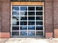Installing five Arm-R-Lite Full View Glass Doors.