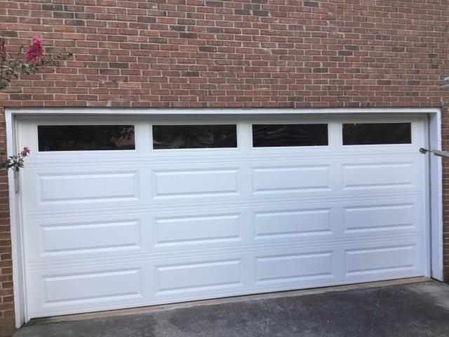 Snellville, GA - Installing CHI 4283 white garage door with windows. Installing LiftMaster 8500w garage door opener and LiftMaster 877LM keypad. Servicing garage door.