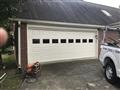 Loganville, GA - Installing CHI 2251 18'x7' garage door with windows. Installing LiftMaster 8355W garage door opener. Installing LiftMaster 877LM Keypad. Servicing garage door.
