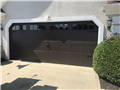 Installing CHI 5283 16'x7' brown garage door with windows. Installing new tracks. Servicing garage door.