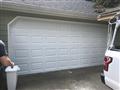 Dacula, GA - Installing CHI 16'x7' garage door. Installing new springs, bracket, tracks, struts and hardware.