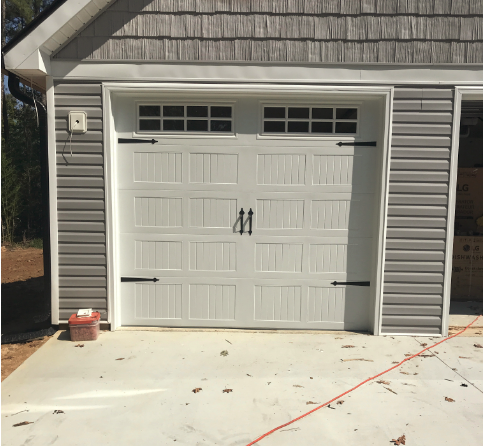 Hoschton, GA - Installing two CHI white 5250 9'x8' glazed stockton garage doors with windows and handles and hinges. Installing two LiftMaster 8355 garage door openers. Servicing garage door.
