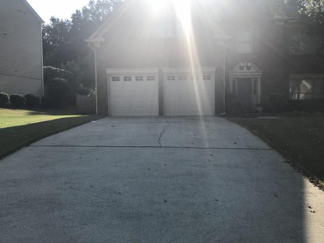 Duluth, GA - Installing two CHI 2251 8'x7' glazed, stockton, desert tan, garage doors with upgraded rollers and torsion springs.