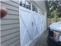 Installing CHI 5334 18'x8' garage door with arched madison windows. Installing LiftMaster 8500W garage door opener. Programming remotes and keypad.