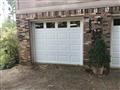 Stone Mountain, GA - Installing two 8'x7' CHI 2283, glazed, white garage doors. Installing low head tracks and trim. Installing torsion conversion and torsion springs.