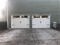 "Suwanee, GA - Installing two CHI 5291 9'x6'9"" garage doors with windows and installing two LiftMaster WLED garage door openers."