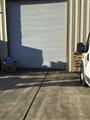 Installing commercial Asta sheet door.
