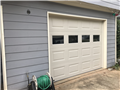 Lawrenceville, GA - Installing two CHI 2251 9'x7' almond garage doors with windows. Installing tracks, trim, and torsion springs on garage doors.