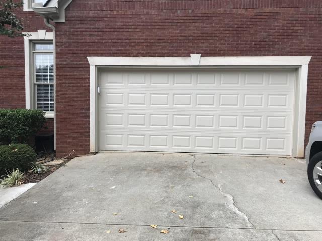 Suwanee, GA - Installing CHI 2283 garage door 16'x7' without windows. Short panel raised.