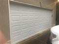Suwanee, GA - Installing a 16'x7' solid white short, raised panel garage door. Installing LiftMaster 8355W garage door opener. Programming remotes and keypads.