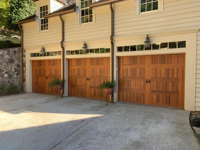 Gainesville, GA - Installing three CHI Accent wood series cedar garage doors, Barcelona ring knocker handles. Installing three LiftMaster 8355W garage door openers with sensors and remotes.
