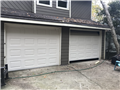 Alpharetta, GA - Installing two 9'x7' almond garage doors. Installing two LiftMaster 8010 garage door openers.