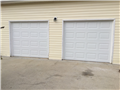 Installing two CHI 2250 garage doors. Installing two 8010 LiftMaster motors.