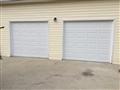 Snellville, GA - Installing two CHI 2250 garage doors. Installing two 8010 LiftMaster motors.