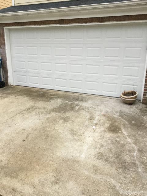 Lawrenceville, GA - Installing 16'x7' garage door. Installing LiftMaster WLED garage door opener. Installing sensor eye and programming remotes.