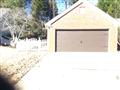 Installing 16'x7' brown garage door with spade handles and hinges.