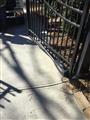 Installing gate arm.