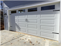 Installing 18'x8' long panel garage door. Installing Liftmaster 8355W garage door opener with two remotes.