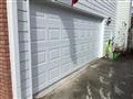 Installing 16'x7' white garage door.