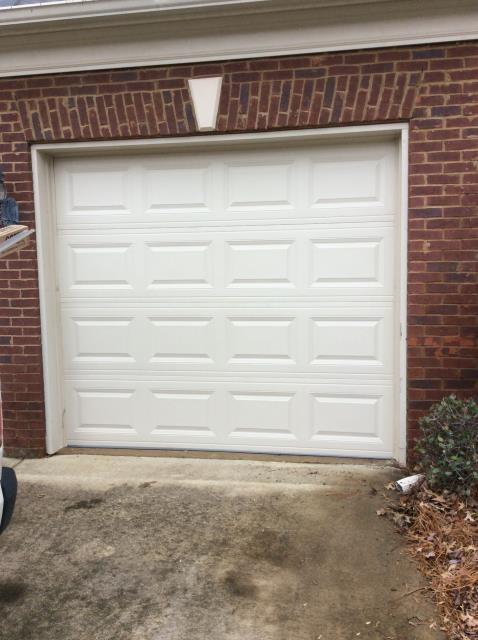 Installing 8x7 traditional short panel raised garage door.