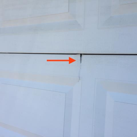 Sugar Hill, GA - Quote for new garage door or section replacement. Customer has cracked garage door that has 3 damaged sections.
