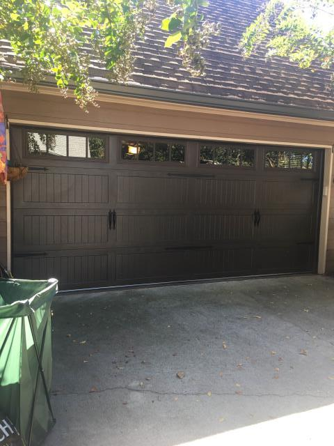 Sugar Hill, GA - Garage door installation. replaced old wood garage door with new steel garage door brown in color with carriage stamp.